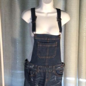 Women's overalls jean fabric worn holes on legs